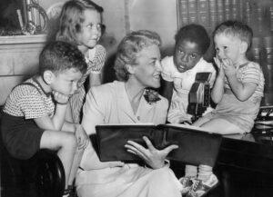 Margaret Chase Smith reading to four children